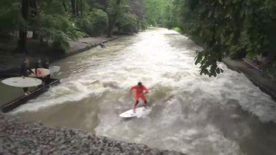 Munich's Man-Made Eisbach Wave Becomes Popular Attraction for Surfers and Tourists